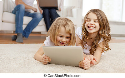 smiling sister with tablet pc and parents on back - family,...