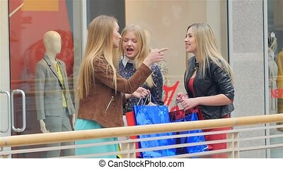 Three girls on a shopping: meeting friends. Slow motion -...