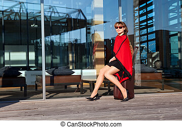 beautiful businesswoman with suitcase on the street -...