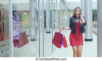 Beautiful blonde goes to store and talking on the phone....