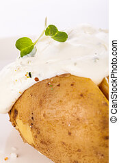 Baked jacket potato with sour cream sauce - Overhead view of...