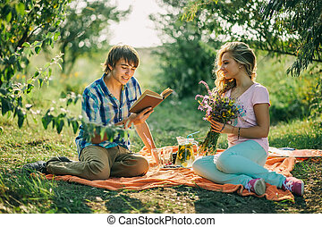 teenage couple dating on picnic - teenage couple first date...