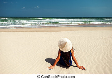 girl on the beach with vietnamese hat