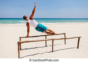 fitness man on the beach - fitness handsome man work out on...