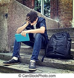 triste, estudante, com, a, livro,