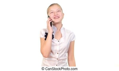 School girl using mobile phone and calls somebody, smiles on...