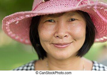 Happy mature Asian Woman close portrait