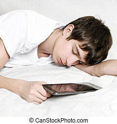 Young Man sleep with Tablet - Tired Young Man sleep with...