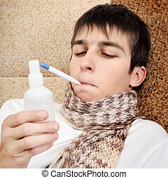 Sick Teenager with Flu - Sick Teenager with Thermometer and...
