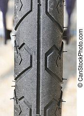 part of the tire on a bicycle. - part of the tire on a...