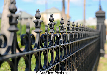 Very narrow dept of field focus on the iron fence - Very...