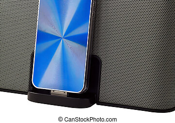 Docking station with mobile phone isolated on a white...