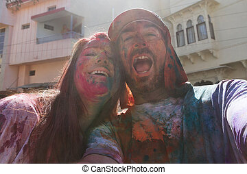 Selfie of couple at holi festival
