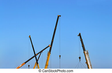 Building site  - Truck crane boom on blue sky background