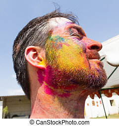 man with colored beard at holi fest
