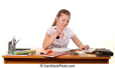 School girl doing her homework thinking about the topic of...