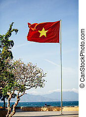 vietnam flag on the beach - vietnam flag with sea view