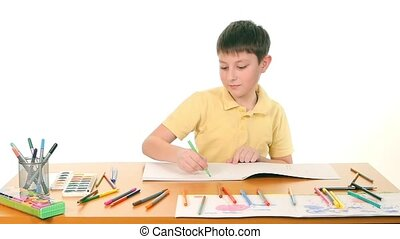 Cheerful little boy with felt-pen drawing on white...