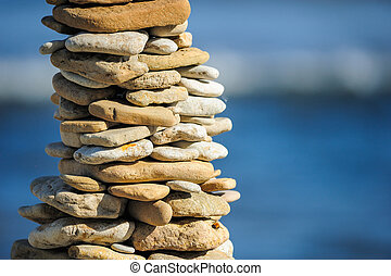 Lasting - Stones laid out in the form of a pyramid on the...