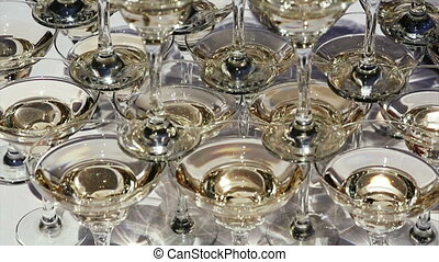 pyramid of champagne glasses being served on a party