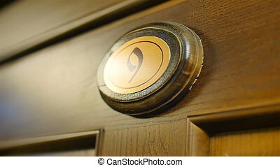 wooden number nine on the door close up - wooden number nine...