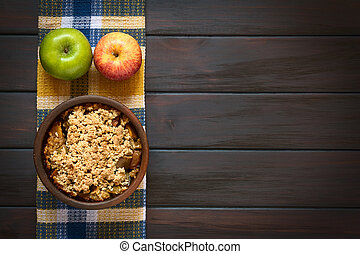 Baked Apple Crumble - Overhead shot of a rustic bowl of...