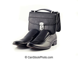 Pochette and Pair of mens classic leather shoes isolated...