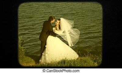 Happy Newlyweds Near Lake At Wedding Day - Video shot of a...