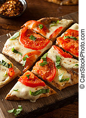 Homemade Margarita Flatbread Pizza with Tomato and Basil