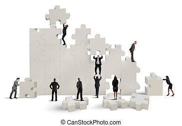 Great puzzle - Business team working to build a puzzle
