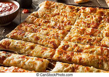 Homemade Cheesy Breadsticks with Marinara Sauce for Dipping