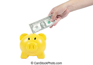 Man hand putting money in to yellow piggy-bank, business...