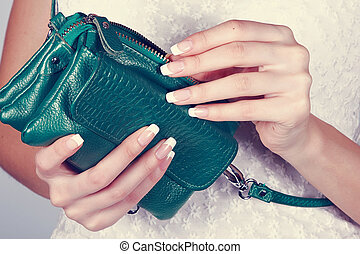 Female hands with manicure with green handbag - Beautiful...