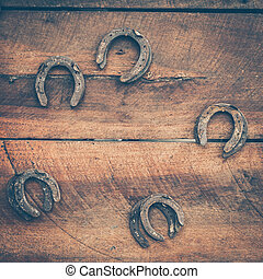old horse shoe on wood background