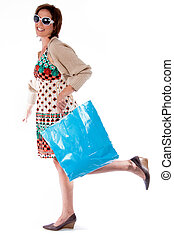 Full length shot of young woman holding shopping bag