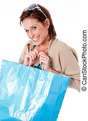 portrait of pretty young women smiling with shopping bag
