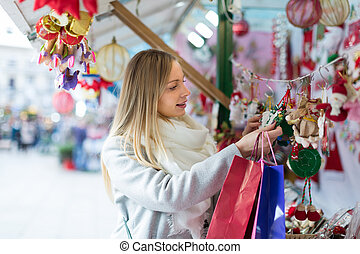 female near counter with xmas gifts - Portrait of...