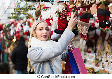 Girl shopping at festive fair - Smiling young blonde girl...