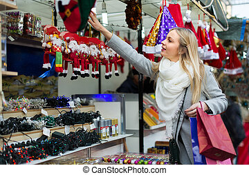 female near counter with xmas gifts - Portrait of smiling...