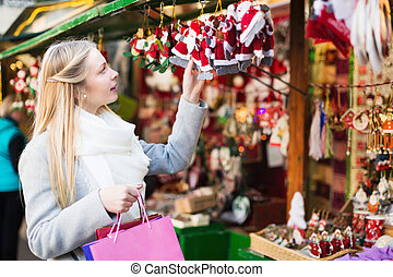 Female shopping at festive fair - Beauty female shopping at...