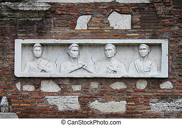 Basrelief in the Appian way of Rome, Italy
