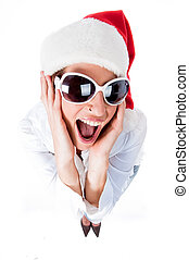 Beautiful young women embracing wearing santas hat isolated...
