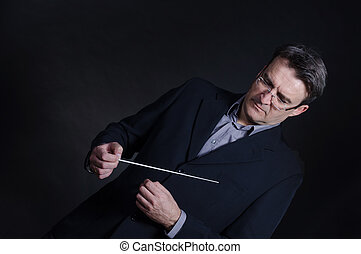 Conductor - Portrait of a conductor using his baton