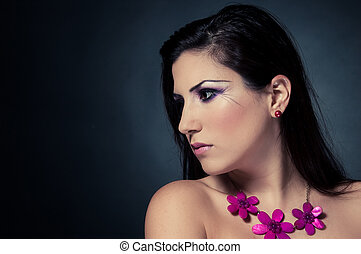 Portrait of a Fashion woman face with stunning make-up on a isolated black background