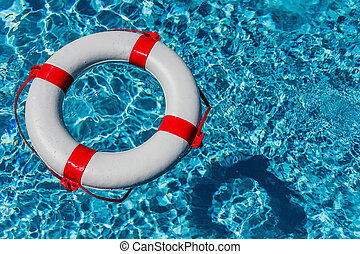 lifebuoy in a pool - an emergency tire floating in a pool...