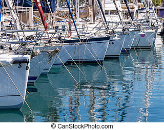 yachts in a harbor, symbolic photo for vacation, cruise,...