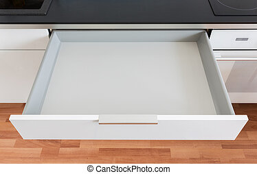 opened kitchen drawer - opened white empty drawer