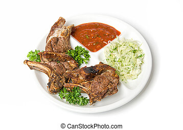 Grilled meat with sauce and vegetables isolated on white...