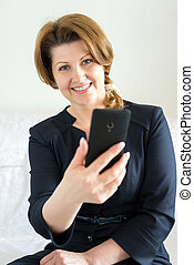 Business woman with a smartphone in the hands