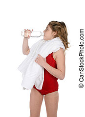 young girl in leotard with water and towel